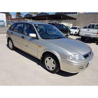 12/2001 Ford Laser LXi KQ 4d Sedan Beige 1.6L